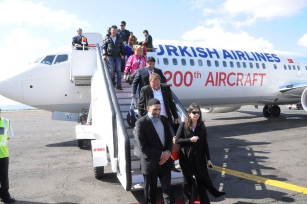 Passengers disembark from the from the Turkish Airlines B737-900 plane at Kilimanjaro International Airport that will embark on the Istanbul Ataturk – Kilimanjaro – Mombasa route.The airline will vie the route five times a week. Photo by Staff Photohrapher